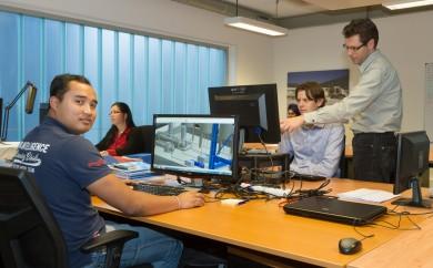 teamfoto op de werkplek